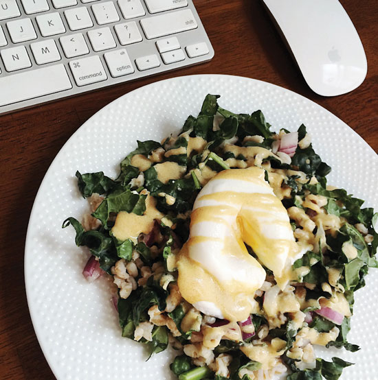 Farro Salad with poached egg and drizzled in a creamy dijon dressing.
