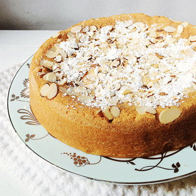 almond ricotta cake on a blue china plate