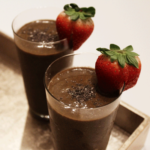 Chocolate Chia Seed Smoothie with strawberries on the rim