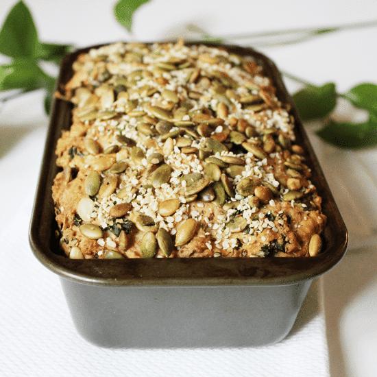 kale and parmesan bread in a metal loaf pan