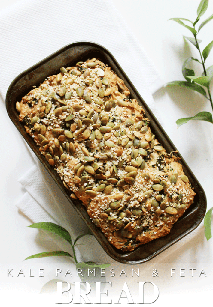 Parmesan Bread Loaf topped with seeds in loaf pan