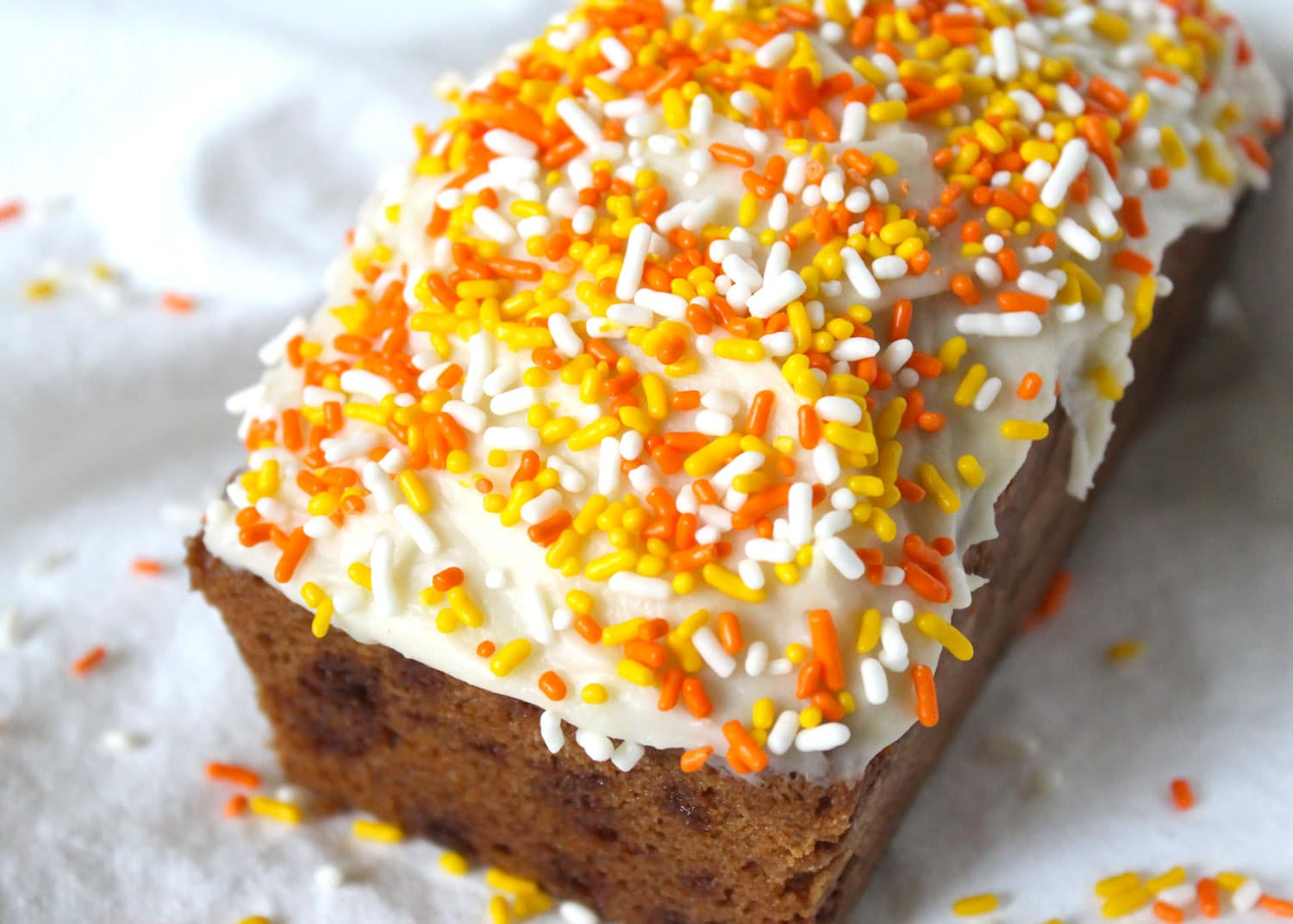 carrot cake bread loaf covered in cream cheese frosting