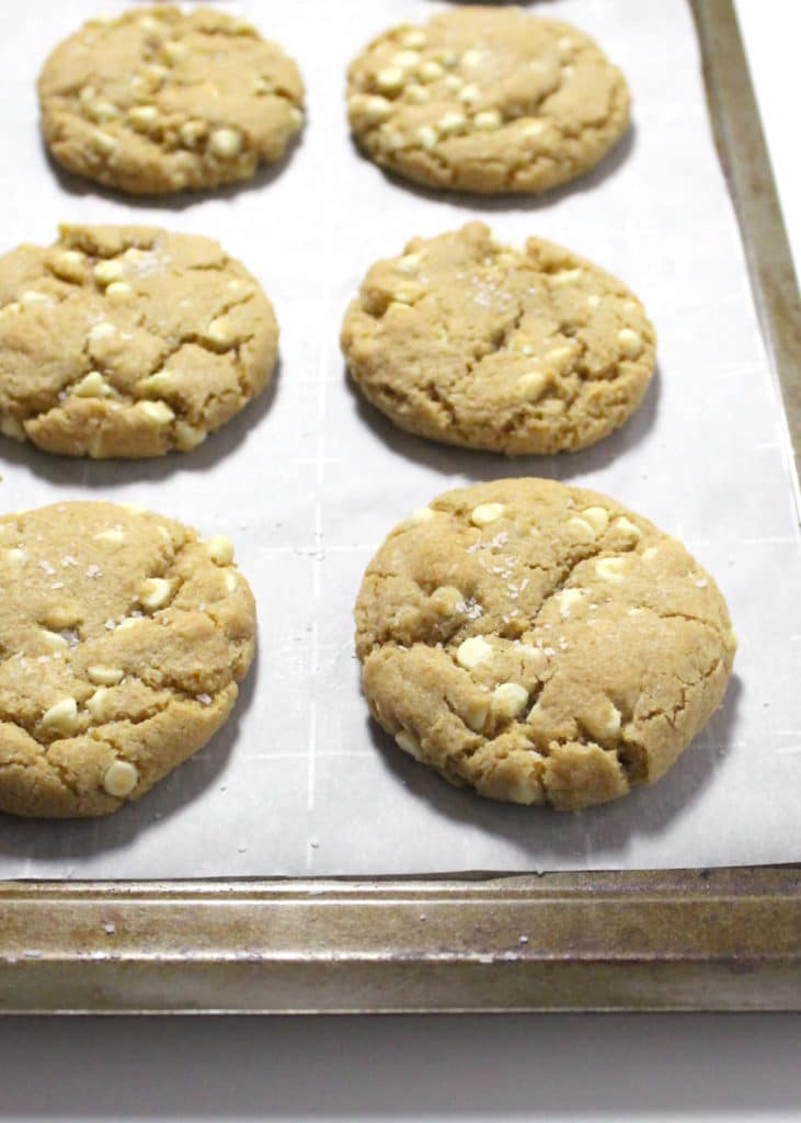 white chocolate chip cookies on baking sheet