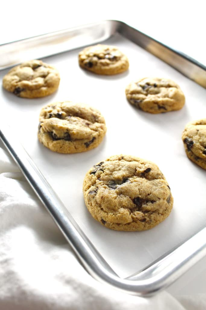 Whole Wheat Chocolate Chip Cookies on a rimmed baking sheet