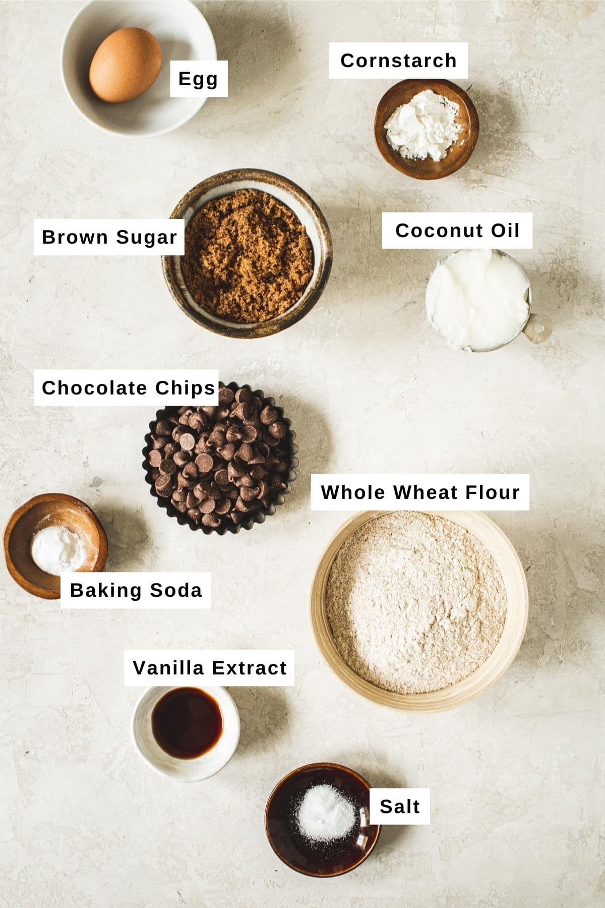 Whole wheat chocolate chip cookie ingredients in various bowls.