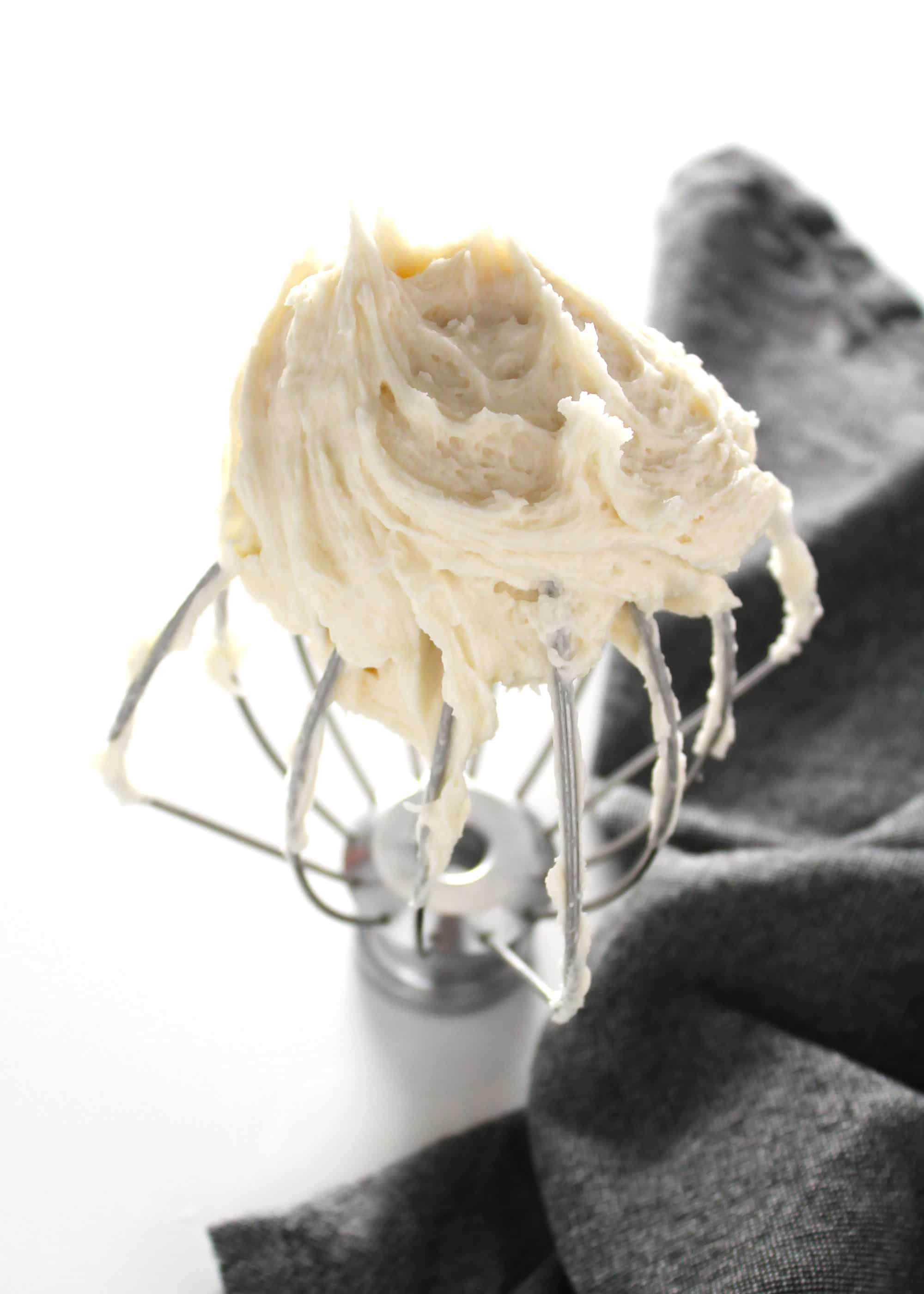 buttercream frosting on whisk attachment