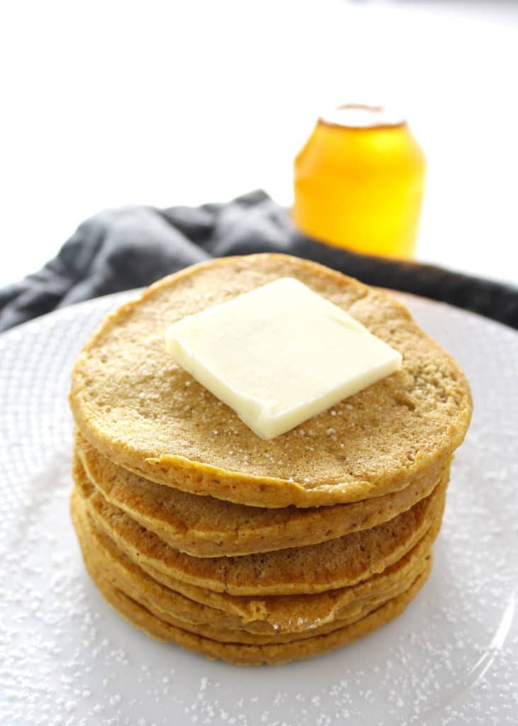 stack of pumpkin pancakes with butter square on top