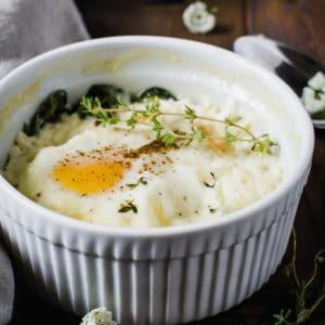 baked eggs in white ramekin