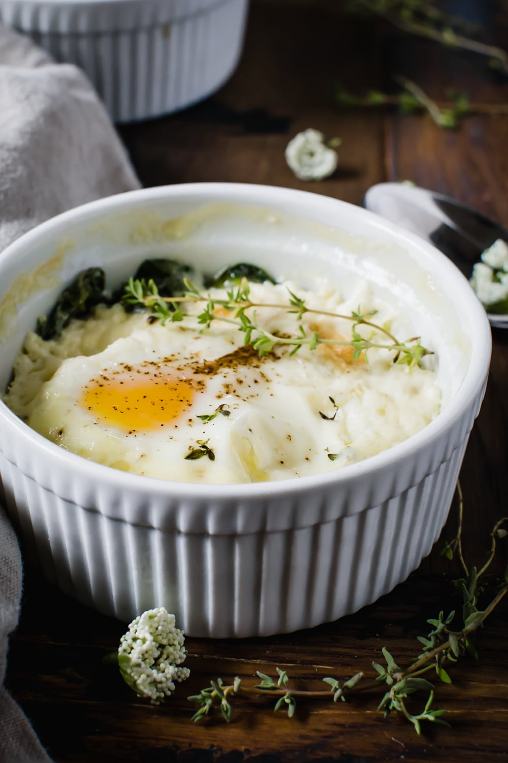 baked eggs in white ramekin