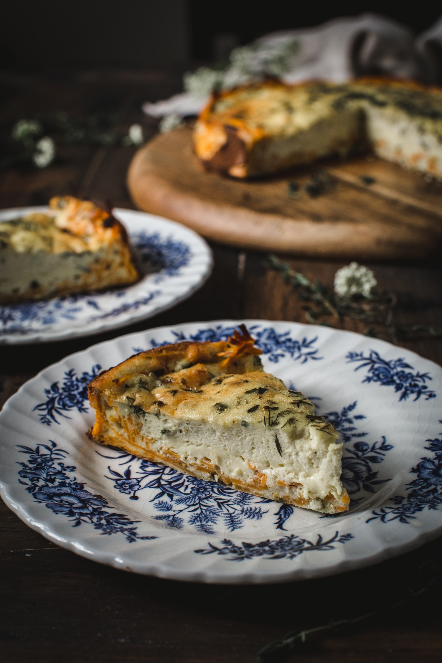 goat cheese quiche on blue and white china plate