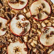 Baked apple oatmeal topped with apple slices.