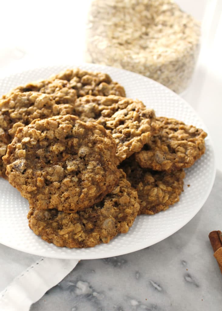 chai spice chocolate chip oatmeal cookies stacked on white plate
