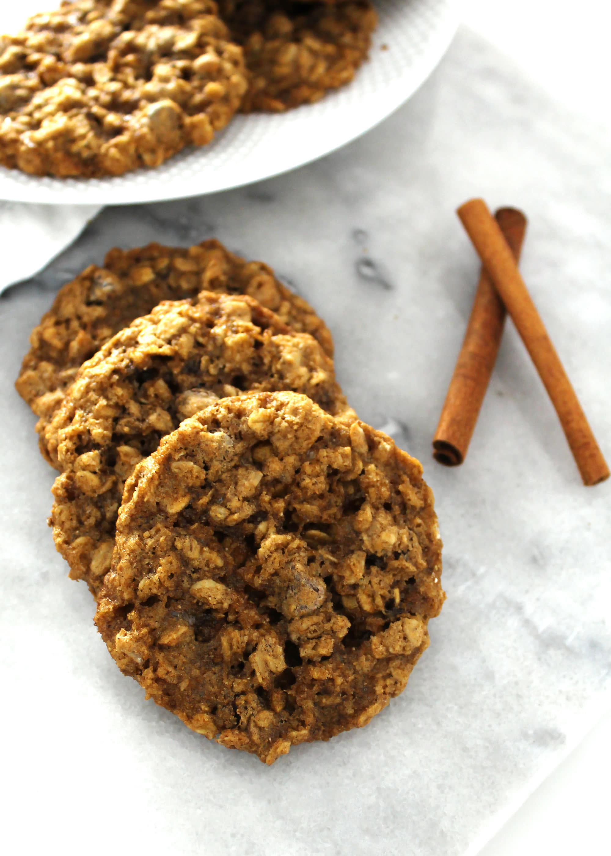 close up of chai spice oatmeal cookies on marble table