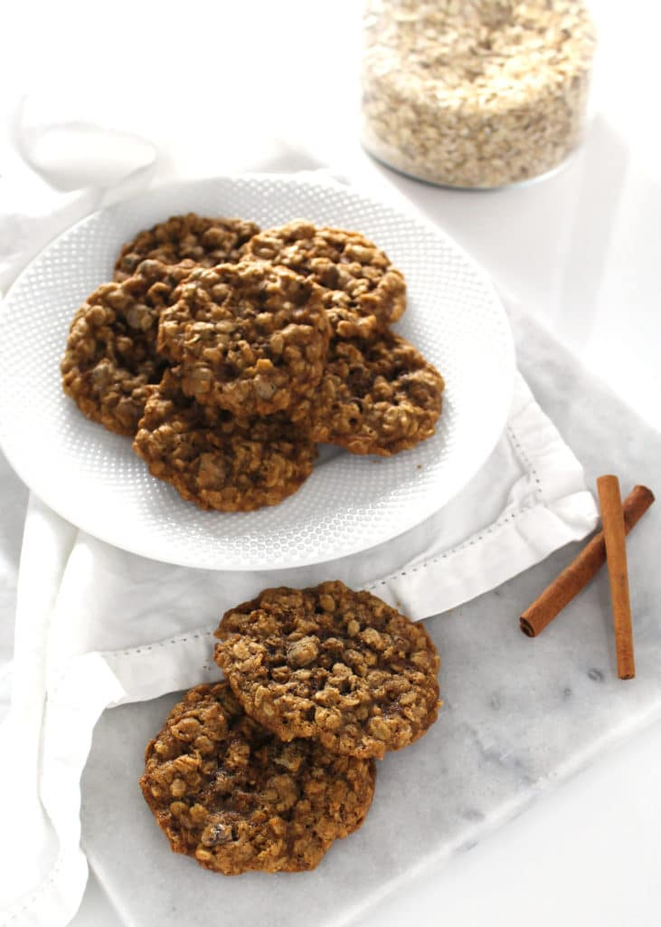 oatmeal chocolate chip cookies stacked on white plate