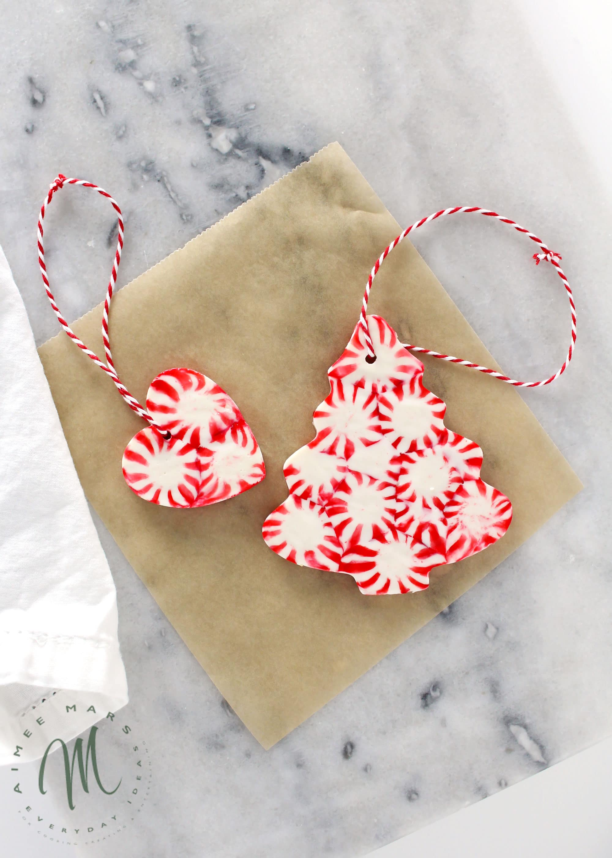 homemade peppermint Christmas ornaments tied with string