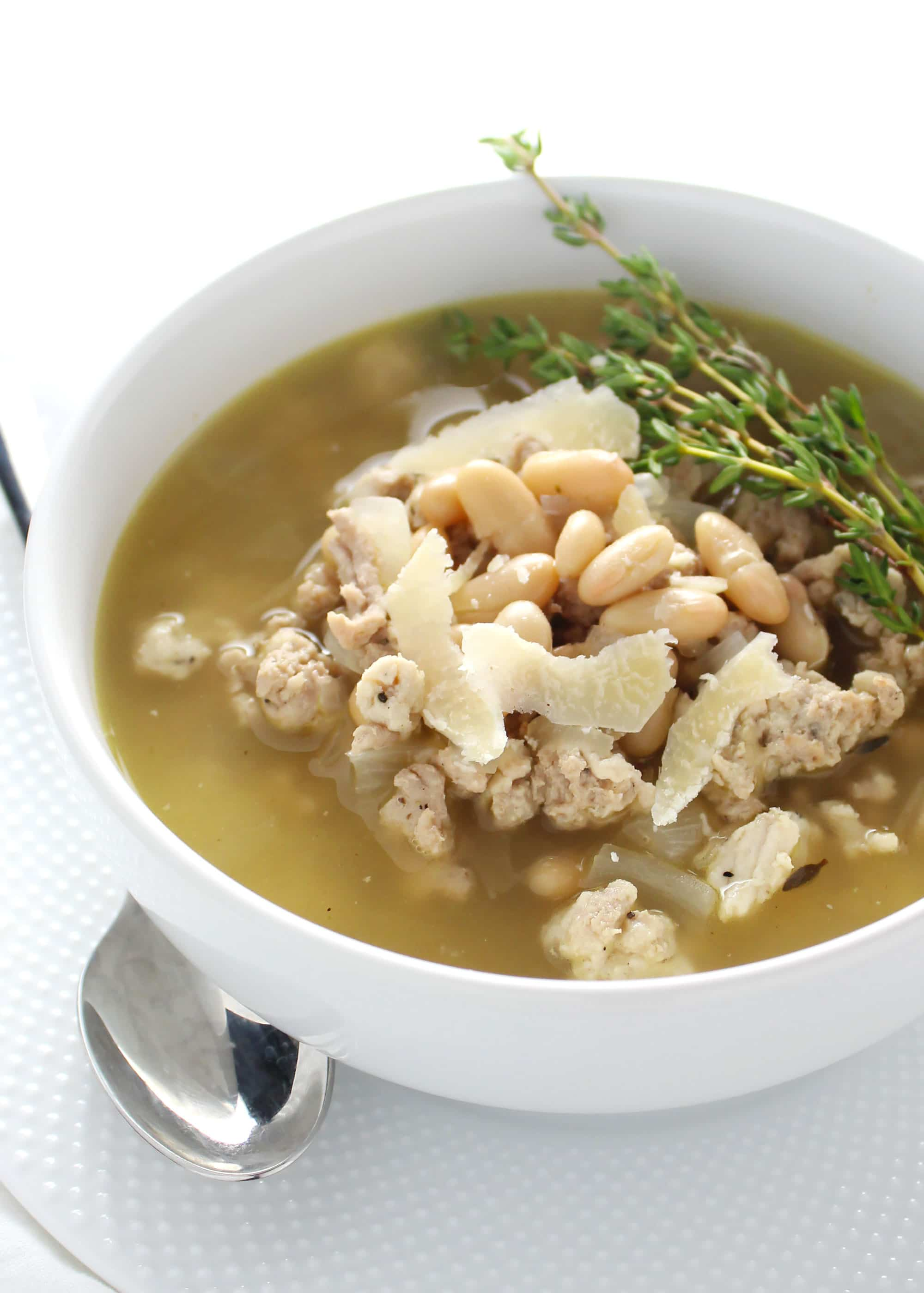 Tuscan white bean stew in white bowl