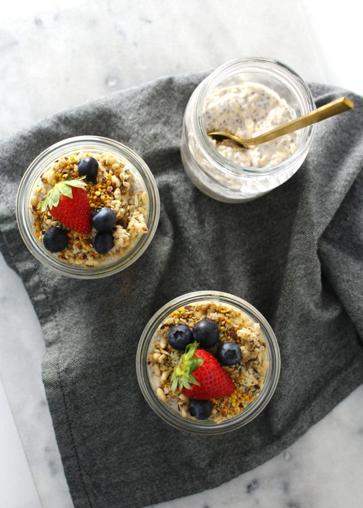 birds eye view of three overnight oats in glass jars
