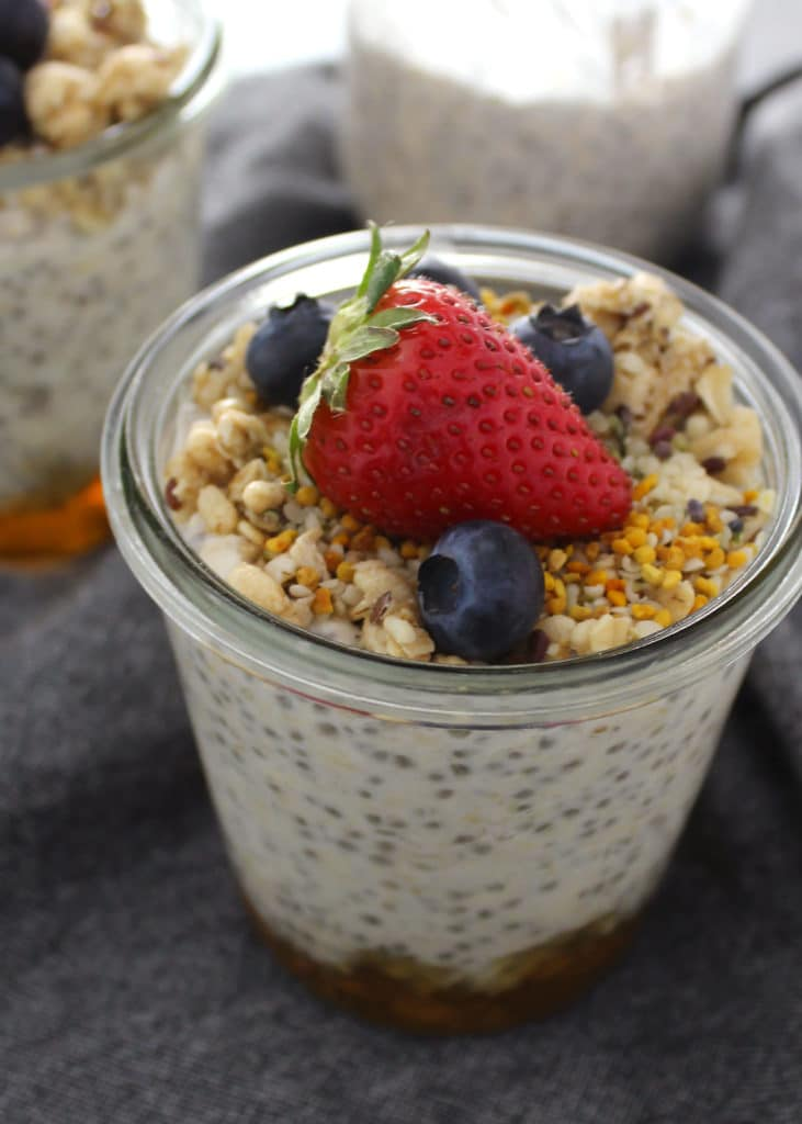 overnight oats topped with bee pollen, strawberry and blueberries