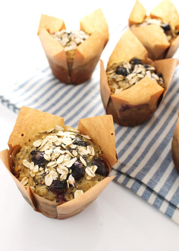 chia oat muffins in brown liners on top of striped towel