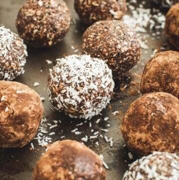 healthy bliss balls covered in coconut flakes and some in cocoa