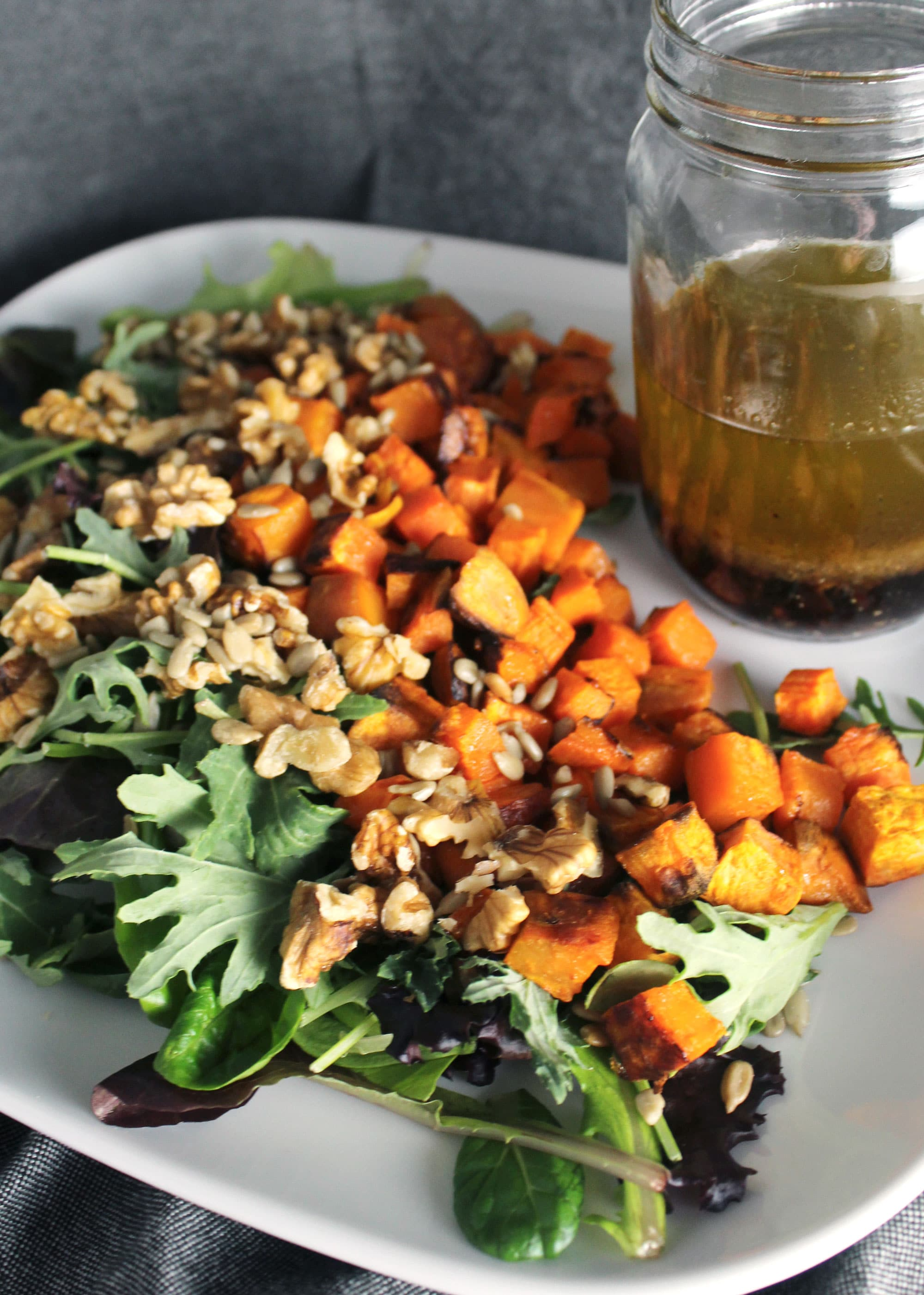 Kale and Walnut Salad with Roasted Sweet Potatoes and Asian Sesame Dressing close up