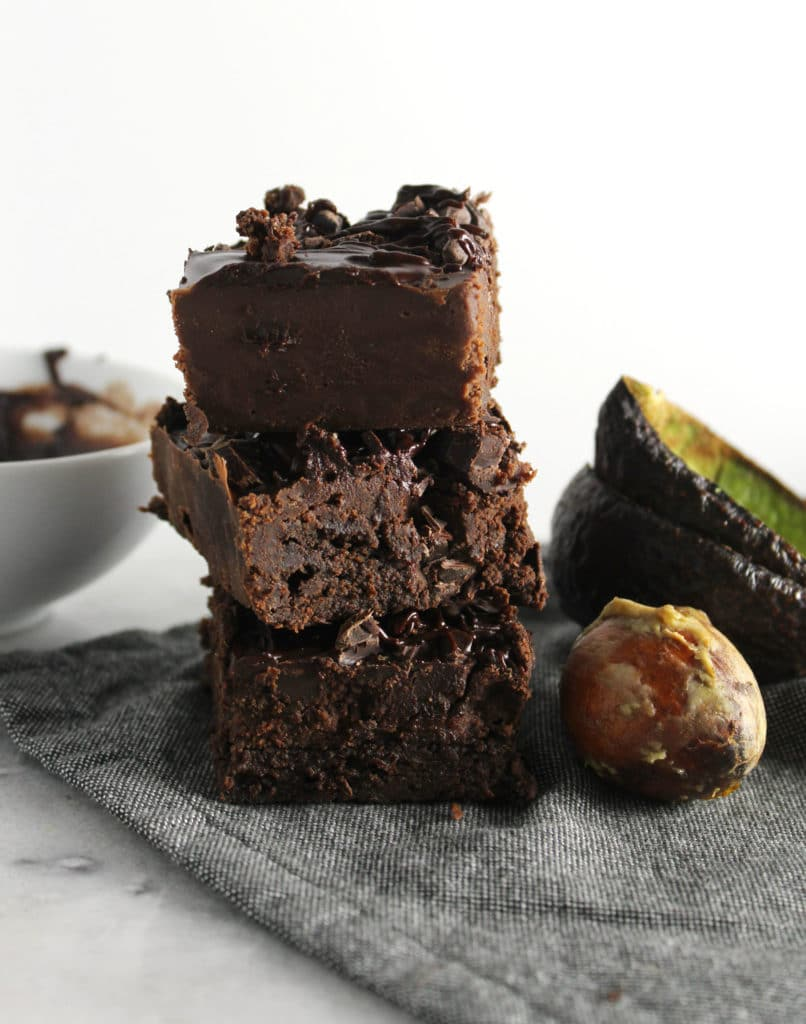 Healthy brownies may seem like a myth but these Avocado Fudge Brownies with Peanut Butter Ganache topping are sweet, fudgy and healthier than the classic | via aimeemars.com | #AvocadoBrownies #FudgeBrownies #HealthyBrownies