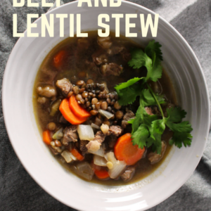 lentil stew in gray bowl with yellow titile