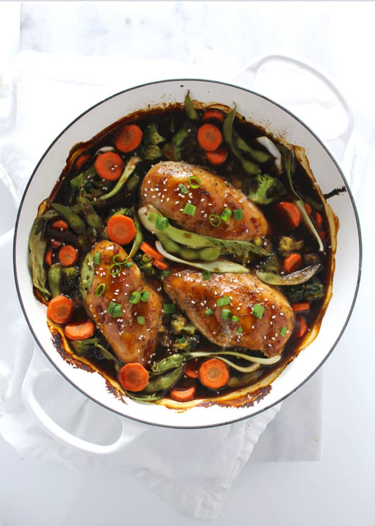 skillet chicken teriyaki in large white pan with vegetables