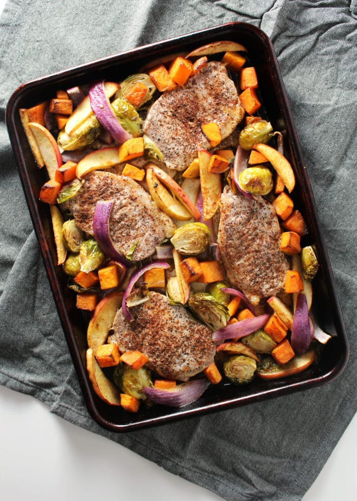 This simple pork chop sheet pan supper is perfect for fall and winter alike with it's seasonal vegetables and baked apples.