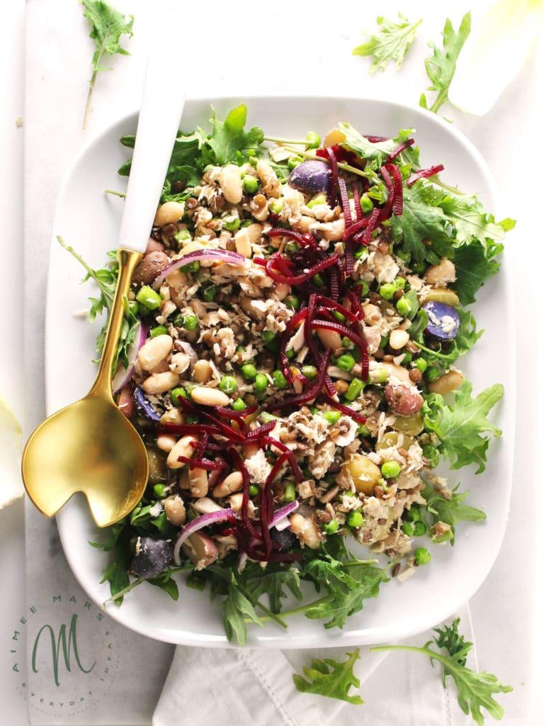 The Madison Avenue Tuna Salad with Mustard Vinaigrette is a swanky salad inspired by NYC and its socialites. Loaded with veggies and full of flavor | via aimeemars.com | #TunaSalad #MustardVinaigrette #VeggieSalad