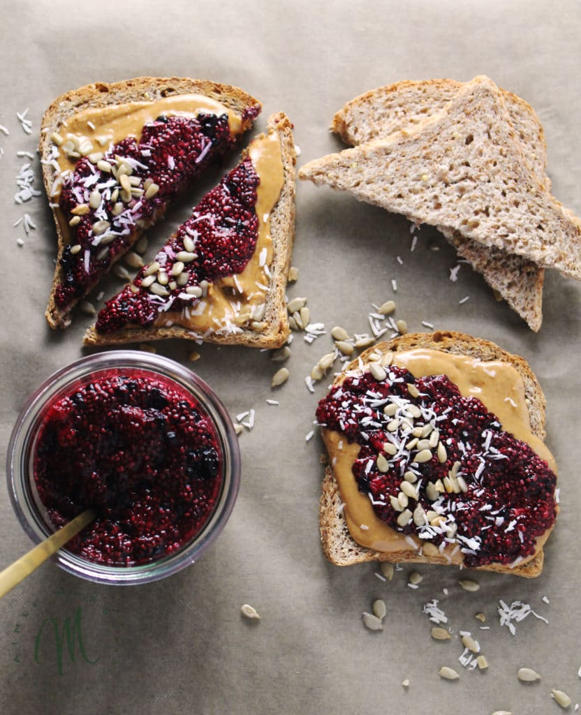 This simple recipe for Mixed Berry Chia Seed Jam Peanut Butter Breakfast Toasts will leave you satisfied and with plenty of jam for the week   via aimeemars.com   #ChiaSeedJam #BreafastToast #HomemadeJam