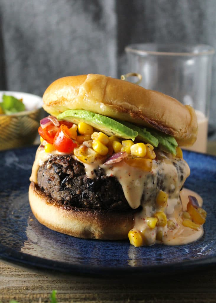 The Southwest Black Bean Burger with Sweet Chili Mayo is a meatless weekend meal family favorite. The sweet and spicy mayo combined with the corn salsa create a Southwest flavor explosion | via aimeemars.com | #SouthwestBurger #BlackBeanBurger #SweetChiliMayo #MeatlessMeal
