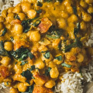 Chickpea spinach curry over rice close up.