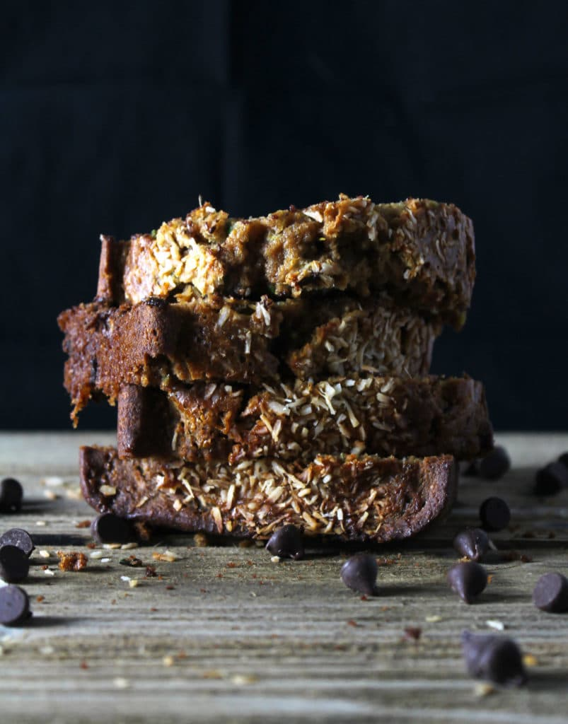 The Olive Oil Chocolate Chip Zucchini Bread is a slightly healthier version of the classic and is packed with zucchini as well as chocolate chips | via aimeemars.com | #ZuchiniBread #ChocolateChipBread #QuickBread #HealthyZuchiniBread
