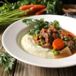 This Crockpot Beef and Vegetables Over Cauliflower Mash recipe is one of my easy go-to weeknight meals when I need something healthy for the family | via aimeemars.com | #BeefStew #CrockpotMeals #CauliflowerMash