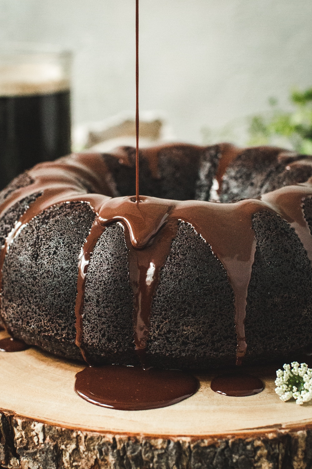 Chocolate ganache dripping down side of chocolate bundt cake.