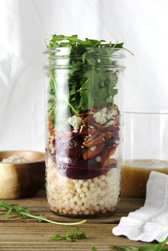 The Spring Stone Fruit Salad Jars are the perfect clean eating option for your lunch, great for meal prep, and is drizzled with a smooth vinaigrette | via aimeemars.com | #MealPrep #StoneFruit #SaladJars