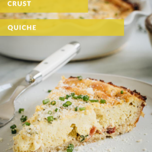 yellow and white titled slice of quiche on white plate