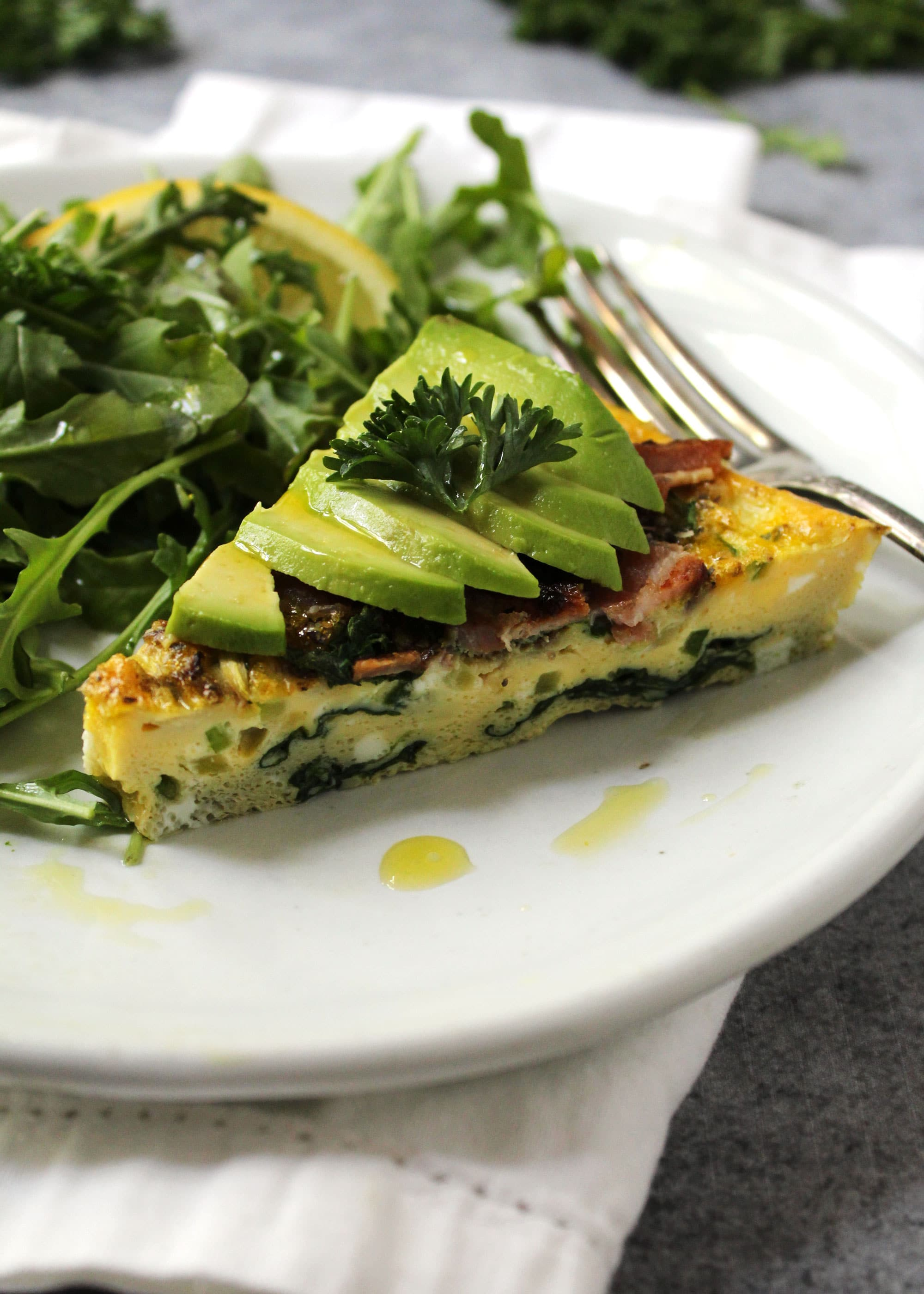 California frittata topped with avocado slices.