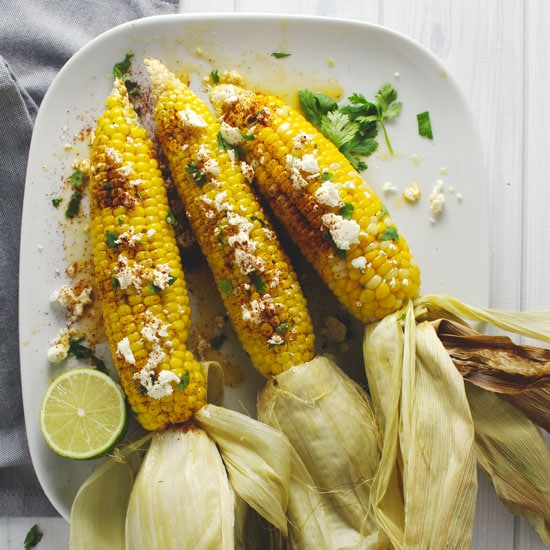 This Roasted Cilantro Lime Corn is a simple summer side dish that's fun to eat and enjoy when the other parts of your meal are being thrown on the grill | via @AimeeMarsLiving | #Roasted #Corn #CilantroLime