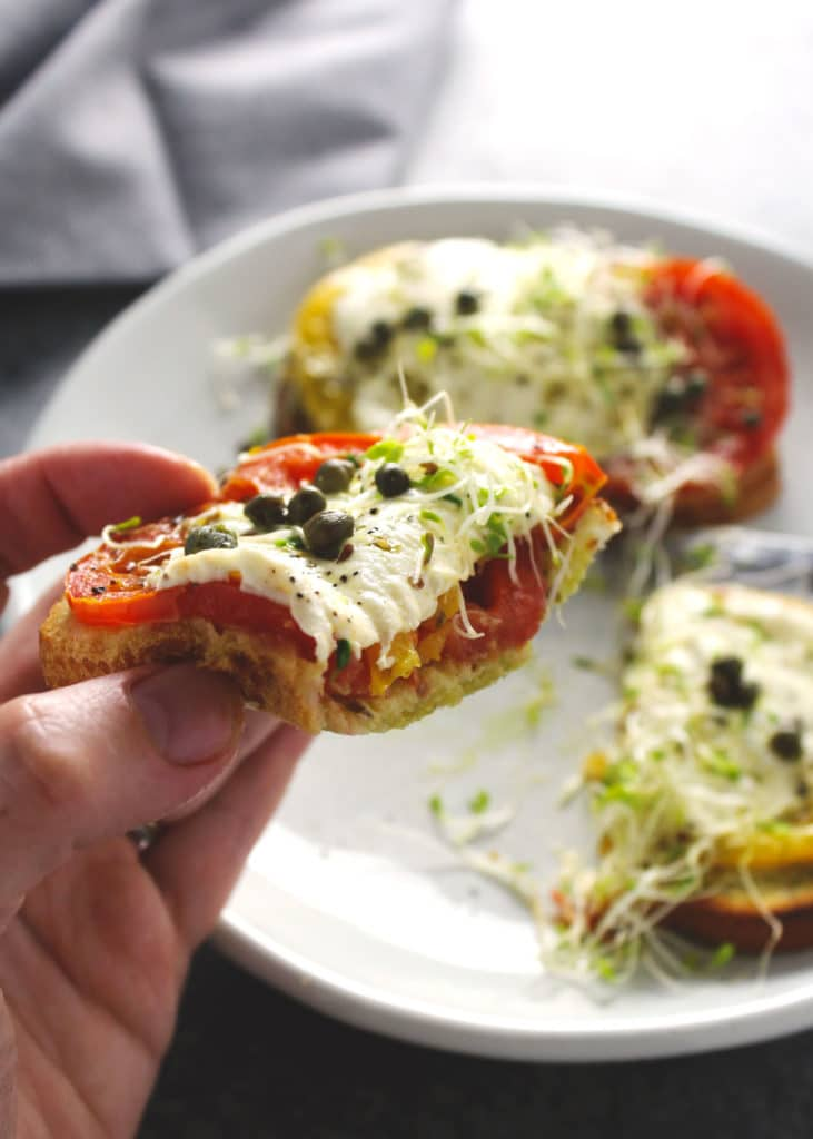 There's something summery about toasted crispy bread drizzled with pesto and topped with melty cheesy covered tomatoes and this tomato sandwich has it all   via @AimeeMarsLiving   #TomatoSandwich #Heirloom