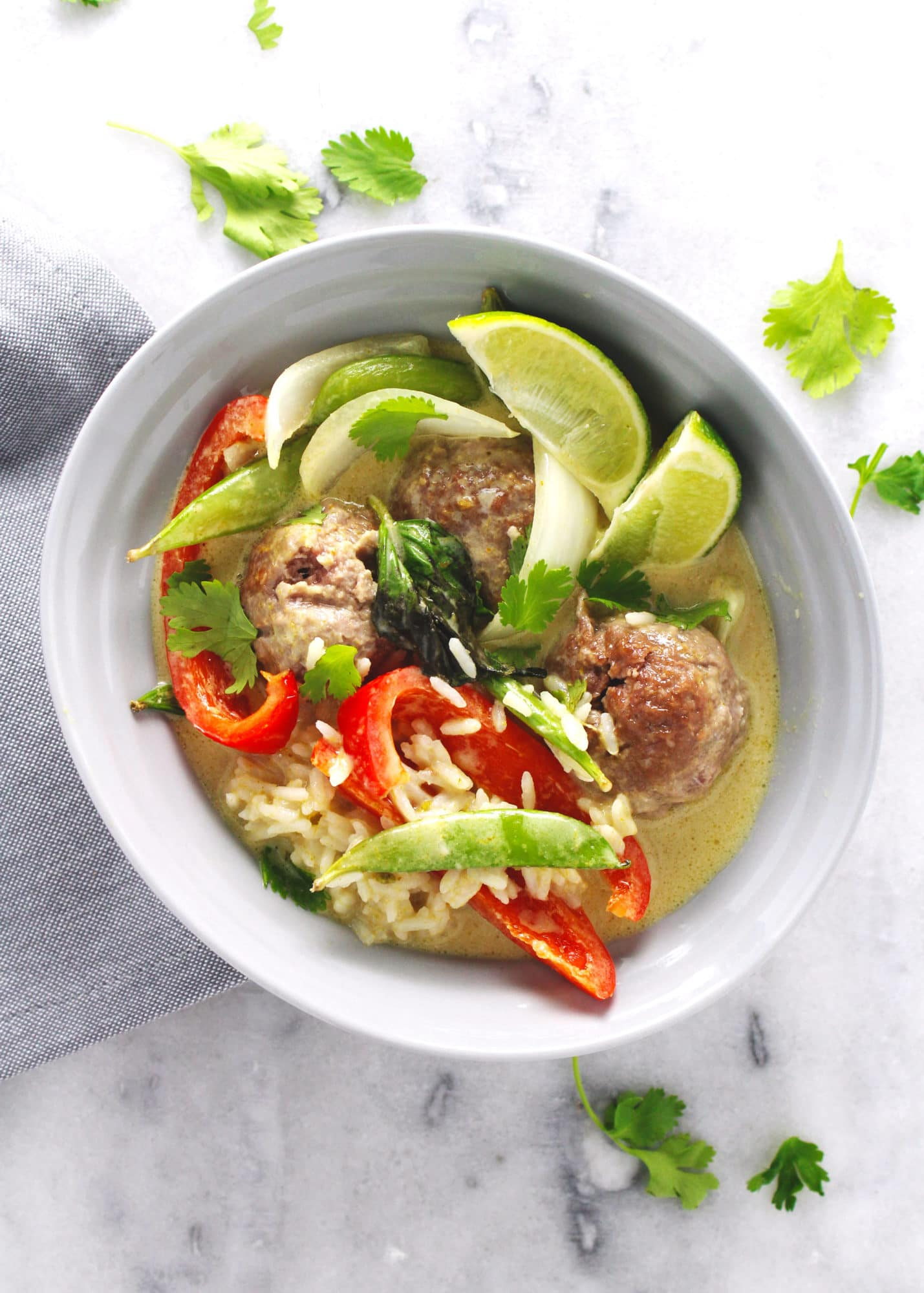 This bright and beautiful one pot meal of Meatballs in Green Curry Sauce is a healthy, gluten-free option for dinner when you want something exciting and may have about an hour to prepare it | via @AimeeMarsLiving | #Meatballs #GreenCurry #OnePot