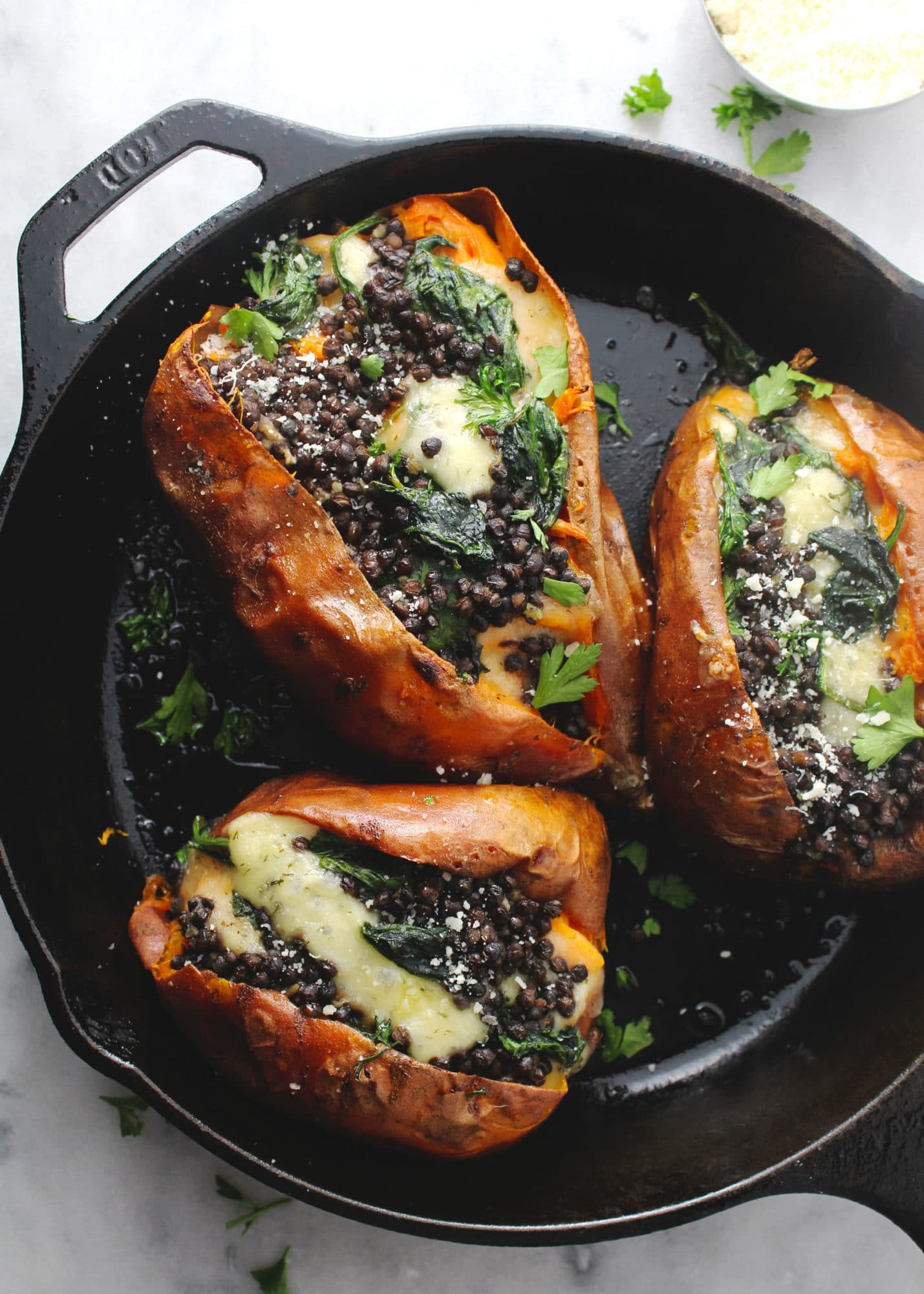 Loaded with Havarti cheese, creamed spinach, and garlic roasted lentils, these baked sweet potatoes really are the best ever | via @AimeeMarsLiving | #Loaded #SweetPotatoes #Lentils