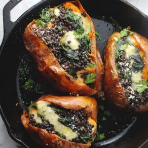 Loaded Vegetarian Sweet Potatoes in a black skillet.
