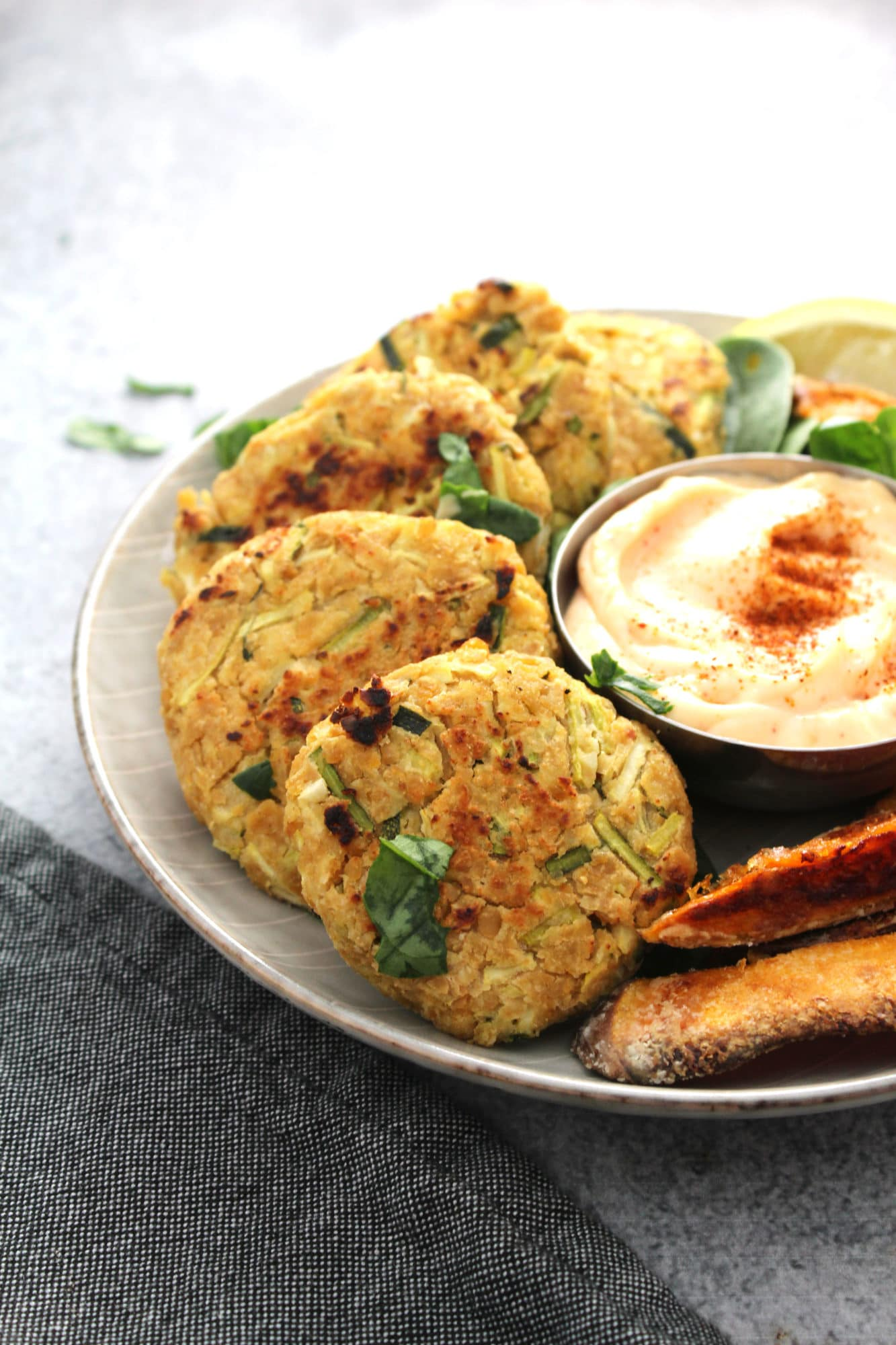 Chickpea Zucchini Fritters are perfect when you want a sophisticated vegetarian dinner that is super tasty and fun (work well as burgers too) | via @AimeeMarsLiving | #Chickpeas #Fritters #Zucchini #SweetPotatoWedges