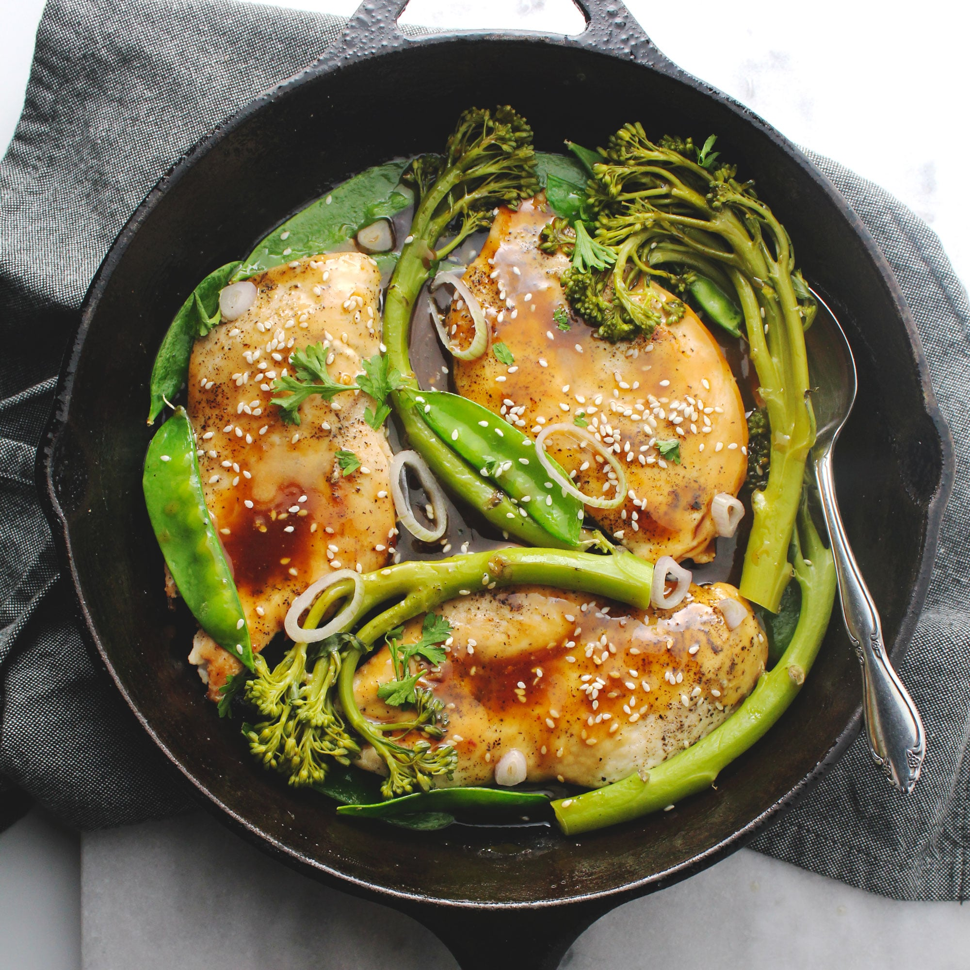 18 Minutes is all it takes to make this delicious sesame honey glazed chicken paired with snap peas and broccolini for a complete meal with a magical sauce | via @AimeeMarsLiving | #Sesame #Chicken #Quick