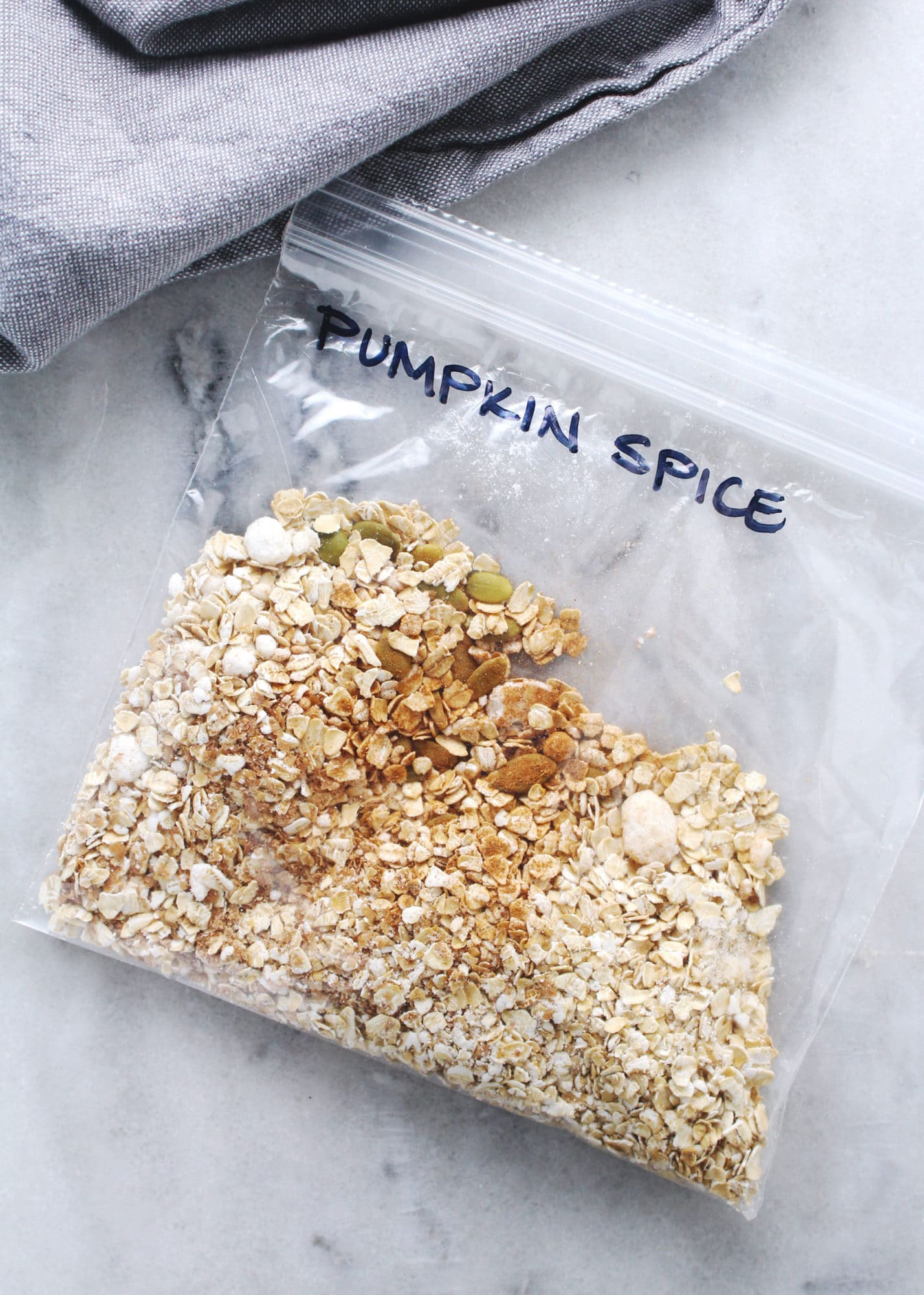 pumpkin spice instant oatmeal in zip-top bag on marble background