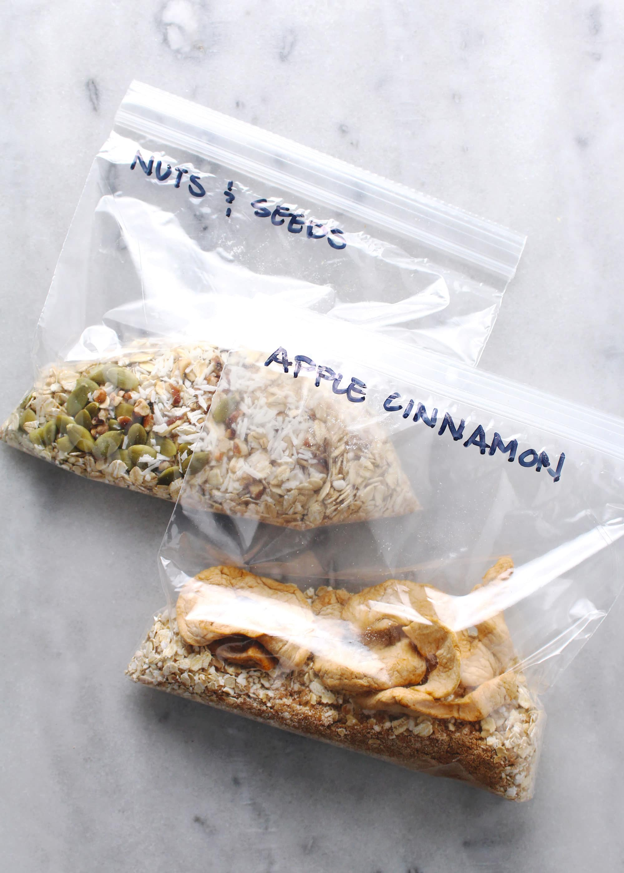 flavored instant oatmeal packets in zip-top bags on marble background
