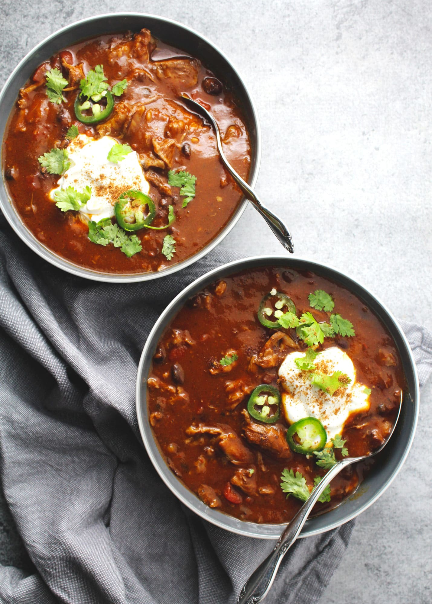 This slow cooked chili is the perfect fall dinner for pumpkin season and packs a sweet and savory taste all in one healthy and delicious bowl   via @AimeeMarsLiving   #Pumpkin #Chili #Beef