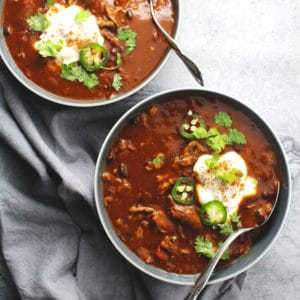 This slow cooked chili is the perfect fall dinner for pumpkin season and packs a sweet and savory taste all in one healthy and delicious bowl | via @AimeeMarsLiving | #Pumpkin #Chili #Beef